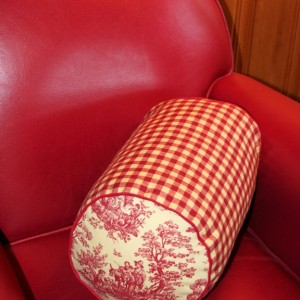 Lavender and kapok-filled bolster pillow. Red and white checkered pattern
